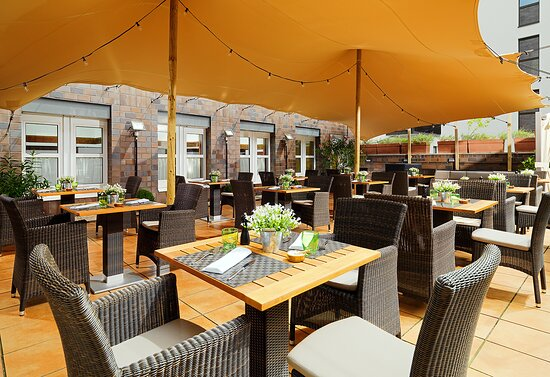 In the summertime we invite to to join us at the inner-courtyard terrace.