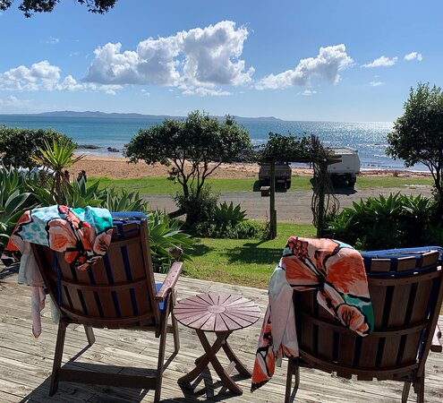 Cable Bay, New Zealand: Relax on the deck with expansive sea views