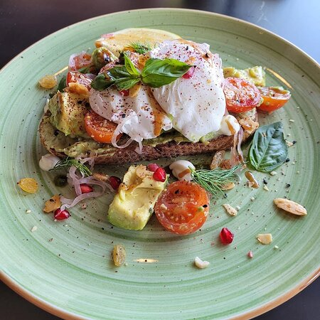 Breakfast! Avocado on sourdough toast with poached eggs