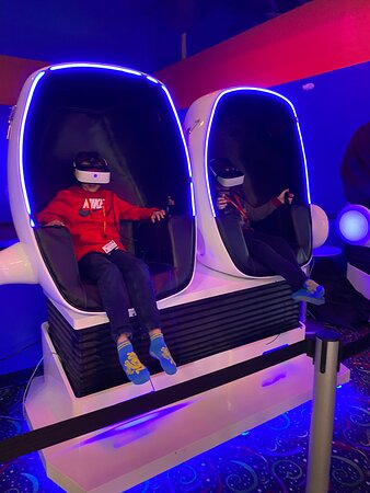 Morganville, NJ: Riding on a virtual rollercoaster with our realistic 9D VR experience! It will keep you on your toes!