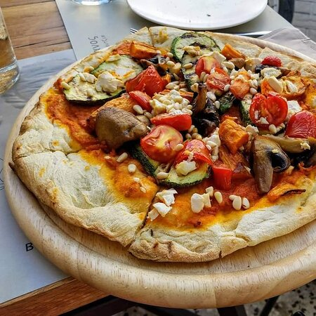 Vegan pizza with roasted vegetables,  pine nuts and tofu! So Very tadty!