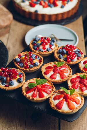 Homemade tartlets with summer fruit