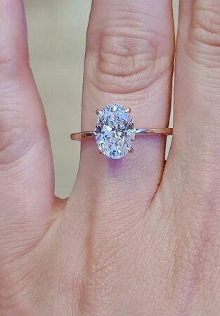 Oval 2.5 ct diamond on our love fancy with under hidden halo setting in rose gold.