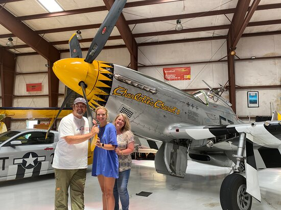Tallulah, LA: Charlotte's Chariot II makes for a pretty cool prop (no pun intended) for a family photo op...and the Mustang in the background isn't bad either!