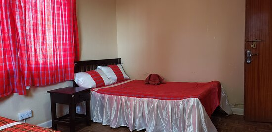 Oloitokitok, كينيا: The twin room at the Teule Guest House. Has a clothes wardrobe, night stand and a dressing table.