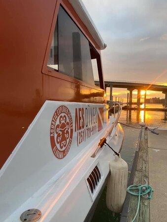 Robertsdale, AL: Sun set at the Caribe Marina - The Explorer dive charter boat.