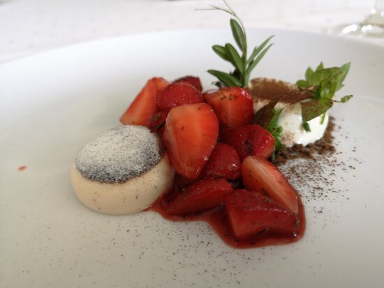 Delicious panna cotta with strawberries and white asparagus ice creams.