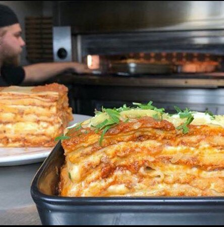 Lasagna Baked the traditional way with Bolognese, mozzarella and Béchamel sauce