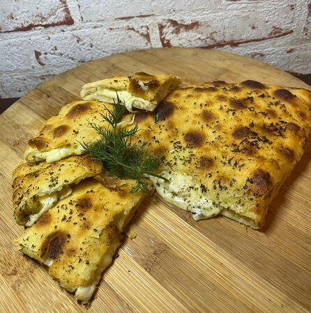 Cheesy Calzone Mozzarella, tasty cheddar cheese, fresh herbs drizzled w/ garlic oil