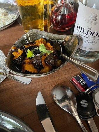 Lamb Shank , Brinjal bhajee, chicken tikka masala balti, Goan chilli king prawn and peshwari nan
