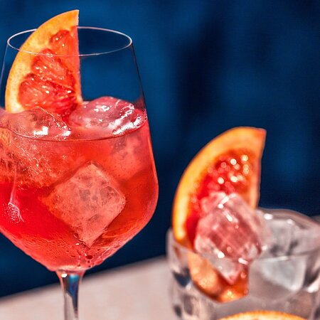 Campari is an alcoholic drink, the flagship product of the Italian company Gruppo Campari. It is a bitter obtained from the infusion of bitter herbs, aromatic plants and fruit in a mixture of alcohol and water, with an intense aroma and a ruby red color. #carusowinebar #playadelcarmen #rivieramaya #wine #bar