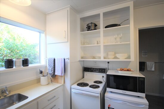 Studio apartment has a large living space with a king and a king single. There is a lovely full kitchen and seperate bathroom, toilet and powder room