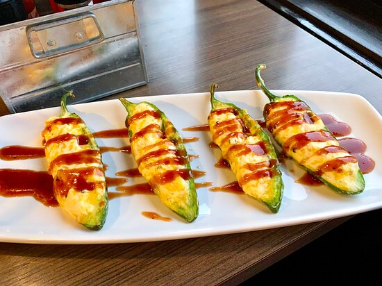 Stuffed Jalapeños with cheddar, corn, cream cheese, and honey BBQ drizzle