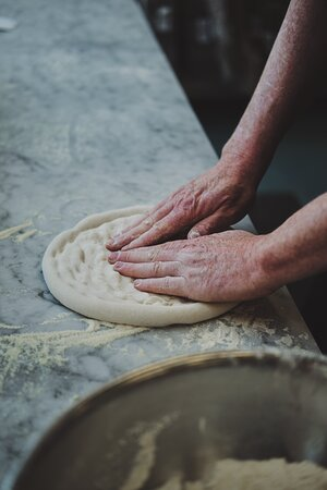 Our dough is the closest you can get to authentic wood fire from our electric oven.