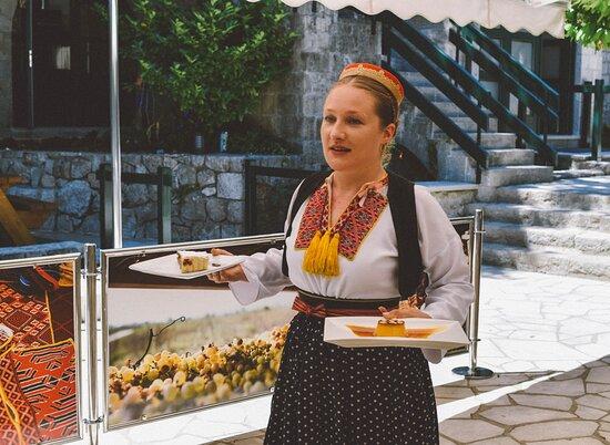 Lady servers at Konavoski Dvori Eco Green Restaurant dressed in the traditional folk attire.