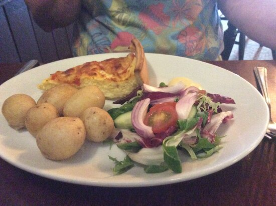 Quiche with trimmings.