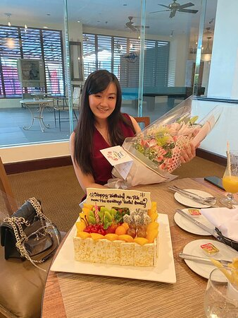me, my self and I with bouquet of flowers and fruity cheesecake