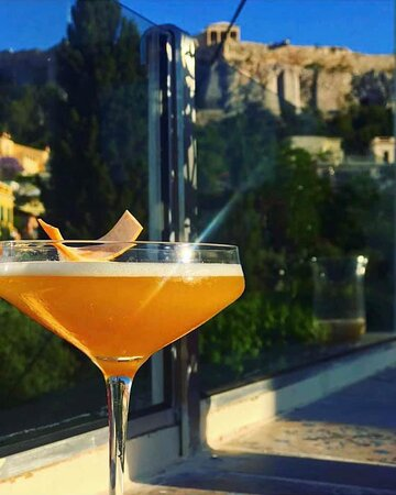 """""""Sunset over Acropolis"""" cocktail with Ouzo, Triple Sec, Mandarin, Lime, Aromatic Bitters"""