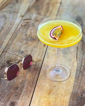"""""""Dyonisus"""" cocktail with Tsipouro, Lime Sugar, Passion Fruit, Aromatic Bitters"""
