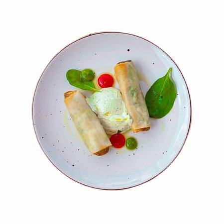 Vegetable pie rolls with spinach, seasonal greens, fresh herbs, Feta cheese, yogurt-herb sauce