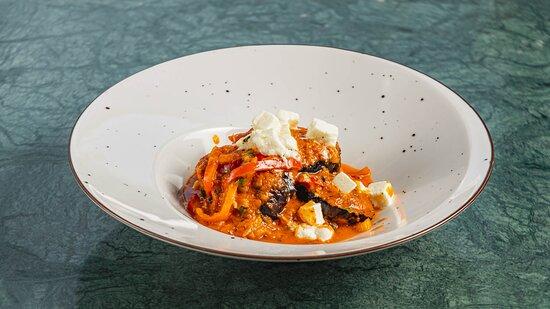 Eggplant saganaki, fresh tomato sauce, Feta cheese, thyme-basil oil
