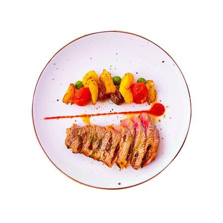 Aged black Angus beef (300g), summer vegetable ratatouille, baby potatoes, Vinsanto wine sauce