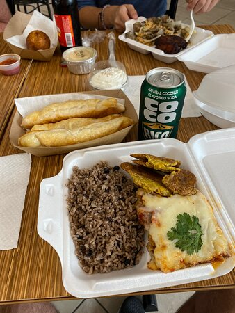 Amazing pastelon (the Thursday special), moro, tostones, and cheese filled quesitos.  Fantastic as always!