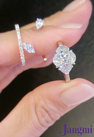 Oval 2.5ct on our half moon three stone platinum setting. Along with our Fancy Love II Marquise & Pear ring.