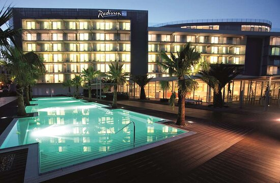 Exterior Hotel and Pool View Logo Evening