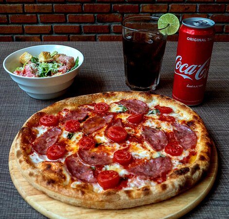 Early Bird Special: 10 Inch Pizza, Caesar Salad and Coke fir Only 189 bht. From 3:30 to 6pm.