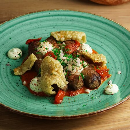 Buffalo Kebab  with spicy Tomato sauce, baked Cherry Tomatoes, Onion with Parsley and 'Petroti' mousse