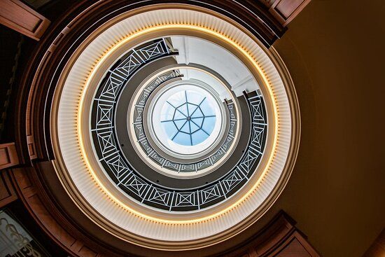 Our circular lobby feature a grand view towards our top hotel floors, lighted by a skylight window