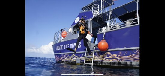 A giant stride into the water to initiate a reef survey