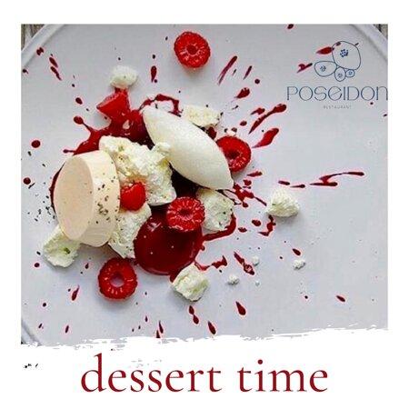 Dessert time with Vanilla Panna Cotta flavored with espresso, raspberry sauce and vanilla ice cream.