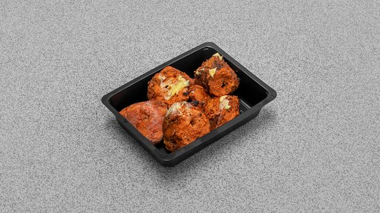 CHICKEN TIKKA.(E,M) Tender and boneless chicken breast pieces marinated in Greek yoghurt and traditional Indian herbs &  spices, cooked to perfection on a flame char grill. Served on a sizzling bed of onions, peppers, ginger, and lemon juice, garnished with coriander. Allergen Key: E-Eggs,M-Milk