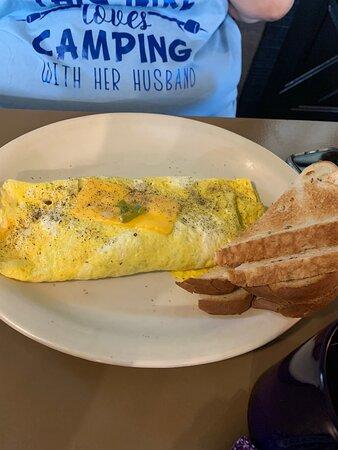 Country fried steak and eggs. Veggie omelette