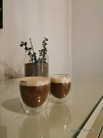 Coffee is an espresso type machine! This is the best invention they could have in a room!