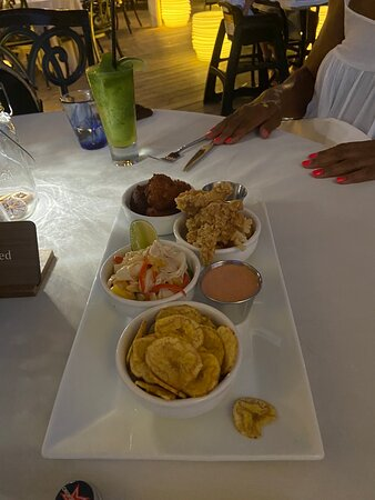 Dinner at the Deck last night was delicious. Appetizers included spring rolls, conch 3 ways and edamame.  Dinner was just as delicious with red snapper, grilled corn and rice; chicken masala with basmati rice and dessert was rum cake and ice cream.