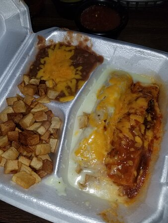 Godley, تكساس: Beef enchiladas & Sour cream enchiladas with a beef enchilada. Potatoes and beans