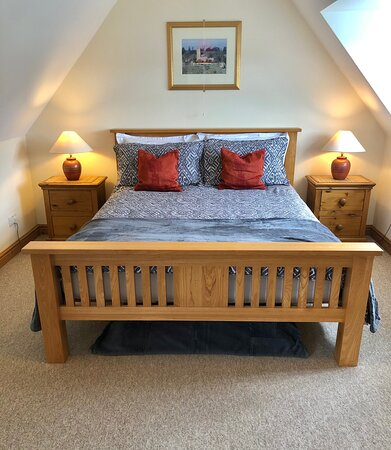 This room sleeps up to three persons. Lovely views down the lane.
