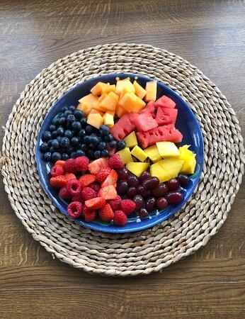 Fresh seasonal fruits for breakfast in summertime.