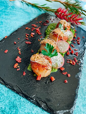 Seared Scallops ................ Four scallops on a bed of pea puree, prosciutto shards topped with garlic butter (GF)