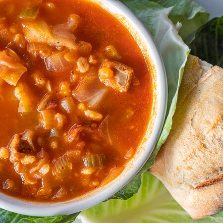 Alsatian red stew (cabbage, bratwurst, and barley) available as a rotating soup du jour.