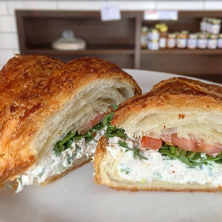 The most popular Le Q lunch item: the chicken salad sandwich. Served with greens and tomato on a fresh croissant. Made with Plum Creek Farms chicken.