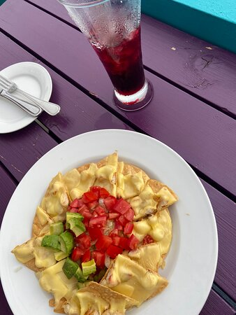 Chicken nachos with complimentary hibiscus iced tea at the roof top bar.