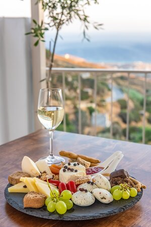 On our veranda overlooking the Aegean Sea you can taste delicious cheese and fine wines from the local Tinos procuction