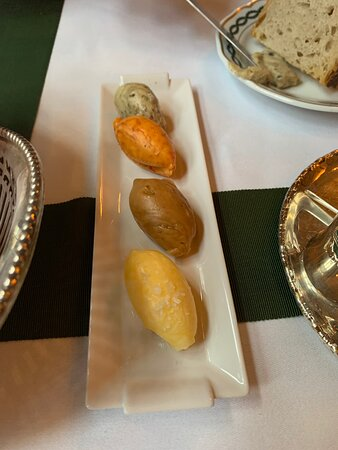 Four types of butter to go with the delicious selection of breads.