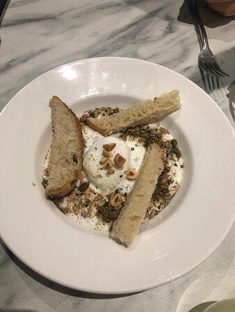 Speckled hens egg breakfast. Mint, yogurt, nuts, seeds and egg.