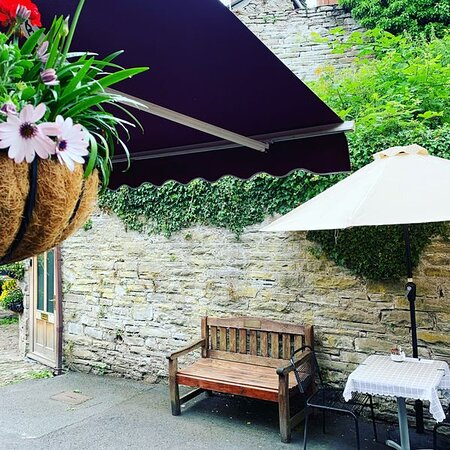 Clever half parasols provide sun shade and respite from the rain!
