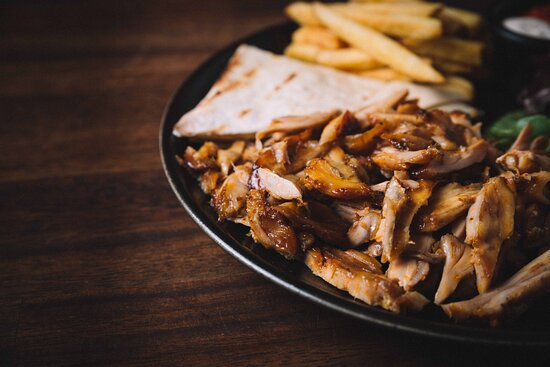 Tavuk Doner (Gyros)  Chicken doner , served with house bread, salad, sauce and chips or rice